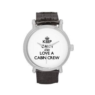 Guarde la calma y ame a un equipo de la cabina reloj