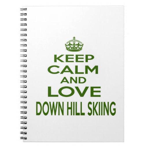 Guarde la calma y ame abajo del esquí de la colina libros de apuntes