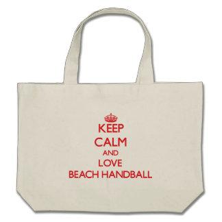 Guarde la calma y ame el balonmano de la playa bolsas