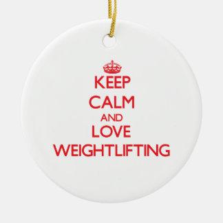 Guarde la calma y ame el levantamiento de pesas adorno navideño redondo de cerámica