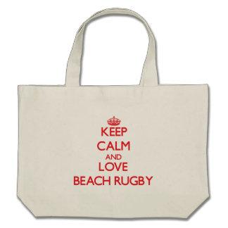Guarde la calma y ame el rugbi de la playa bolsas