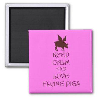 Guarde la calma y ame el volar de los cerdos rosad iman de nevera