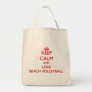 Guarde la calma y ame el voleibol de playa bolsa de mano