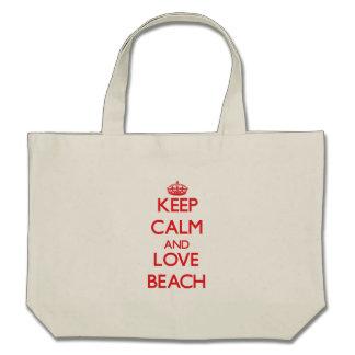 Guarde la calma y ame la playa bolsa de mano