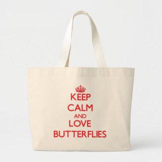 Guarde la calma y ame las mariposas bolsas