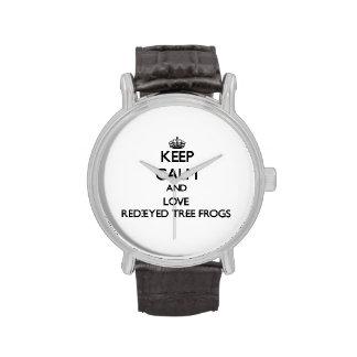 Guarde la calma y ame las ranas arbóreas relojes