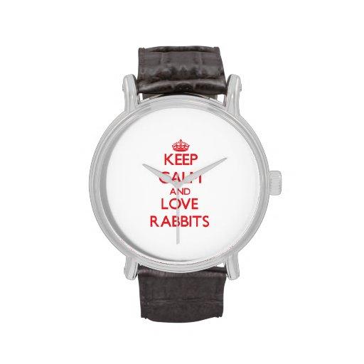 Guarde la calma y ame los conejos relojes