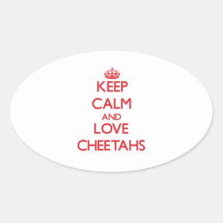Guarde la calma y ame los guepardos pegatina ovalada