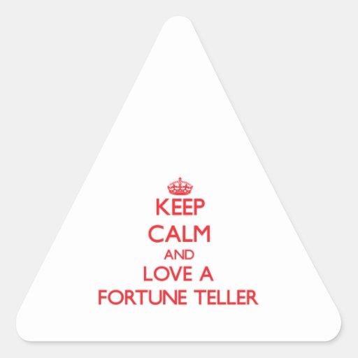 Guarde la calma y ame un adivino pegatina triangular