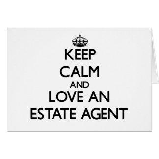 Guarde la calma y ame un agente de la propiedad in felicitación