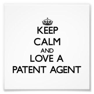 Guarde la calma y ame un agente de patente arte con fotos