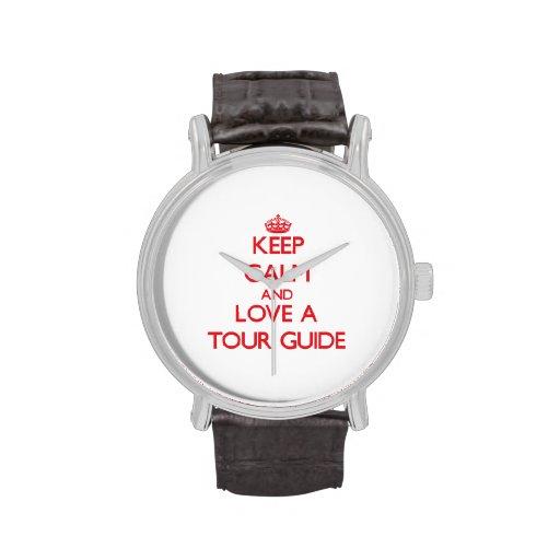 Guarde la calma y ame un guía turístico reloj de mano