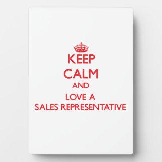 Guarde la calma y ame un representante de ventas placas con fotos