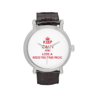 Guarde la calma y ame una rana arbórea relojes
