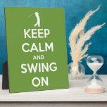 Guarde la calma y balancee en verde placa de plastico