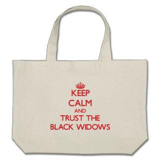 Guarde la calma y confíe en a las viudas negras bolsa