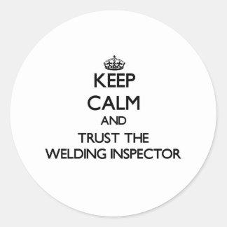 Guarde la calma y confíe en al inspector de la pegatina redonda