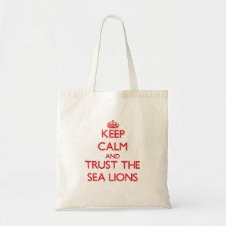 Guarde la calma y confíe en los leones marinos bolsas lienzo