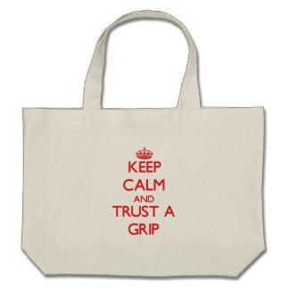Guarde la calma y confíe en un apretón bolsas