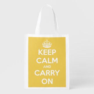 Guarde la calma y continúe el amarillo bolsa reutilizable