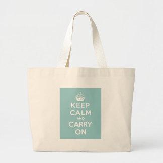 Guarde la calma y continúe en azul claro bolsas