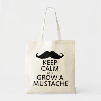 Guarde la calma y crezca un bigote bolsas de mano