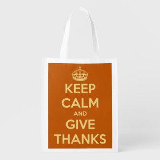 Guarde la calma y dé la calabaza de la cosecha de bolsas reutilizables