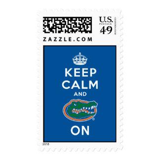 Guarde la calma y el azul del cocodrilo encendido sellos