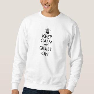 Guarde la calma y el edredón en agujas de costura suéter