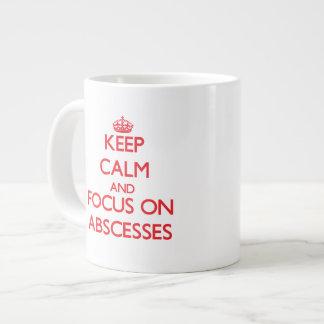 Guarde la calma y el foco en ABSCESOS Taza Grande