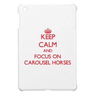 Guarde la calma y el foco en caballos del carrusel