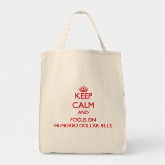 Guarde la calma y el foco en cientos billetes de bolsa