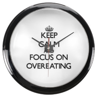 Guarde la calma y el foco en comer excesivamente reloj aqua clock