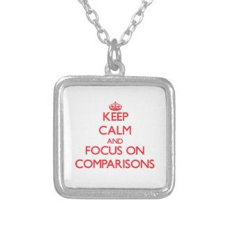 Guarde la calma y el foco en comparaciones colgante