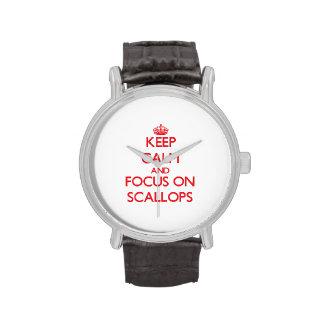 Guarde la calma y el foco en conchas de peregrino reloj