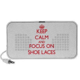 Guarde la calma y el foco en cordones de zapato iPod altavoz