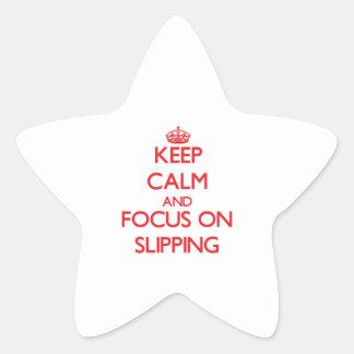 Guarde la calma y el foco en deslizarse pegatina en forma de estrella