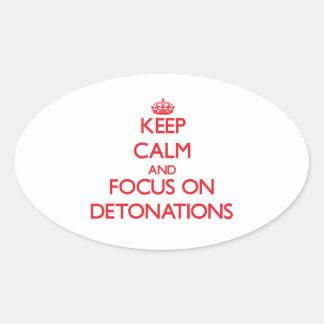 Guarde la calma y el foco en detonaciones pegatina ovalada