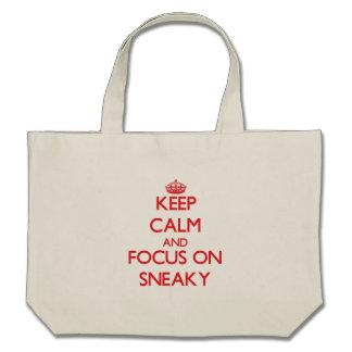 Guarde la calma y el foco en disimulado bolsas de mano