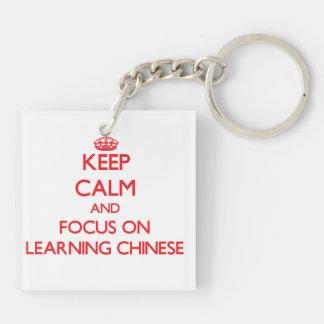 Guarde la calma y el foco en el aprendizaje de llavero