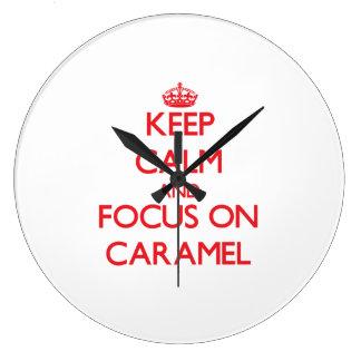Guarde la calma y el foco en el caramelo reloj