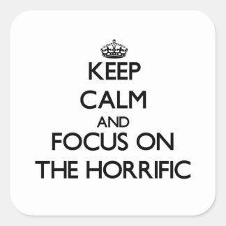 Guarde la calma y el foco en el espantoso calcomanía cuadradase