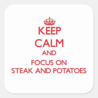 Guarde la calma y el foco en el filete y las pegatina cuadrada