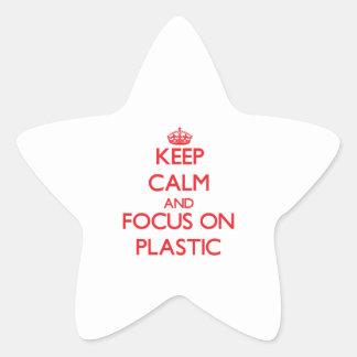Guarde la calma y el foco en el plástico pegatina en forma de estrella