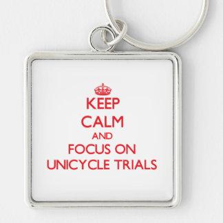 Guarde la calma y el foco en ensayos del Unicycle Llaveros