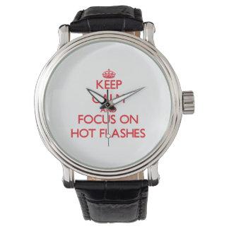 Guarde la calma y el foco en flashes calientes relojes de mano