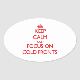 Guarde la calma y el foco en frentes fríos pegatina ovalada