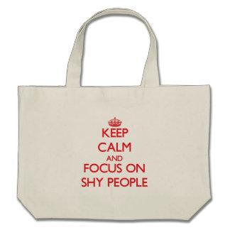 Guarde la calma y el foco en gente tímida bolsa lienzo