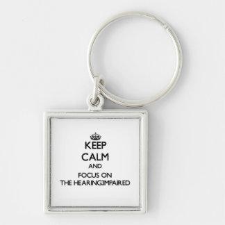 Guarde la calma y el foco en la audiencia - empeor llaveros personalizados