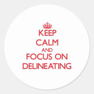 Guarde la calma y el foco en la delineación pegatinas redondas